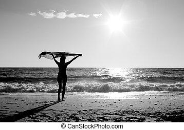 Girl with kerchief play on the beach
