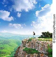 Girl on the peak of mountain