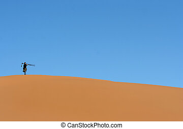 Lonely man on the desert