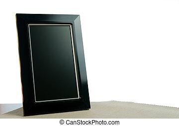 photoframe - black photoframe on the table in white...