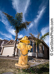 Fire Hydrant - A yallow fire hydrant located in front of a...