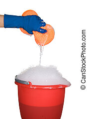 Cleaning sponge and bucket of soapy water - Worker...