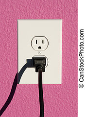 Wall outlet and plug - A clean image of a 110 volt wall...