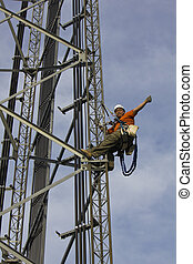 Climber giving signs while climbing 200 self support tower