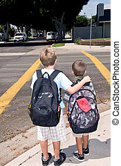 Waiting at crosswalk - Two brothers wait at a crosswalk for...