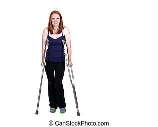 Woman on Crutches - A beautiful woman using a set of medical...