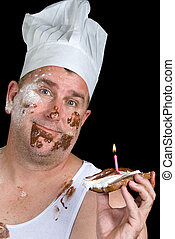 Gourmet chef - A chef shows off his failed cake consisting...