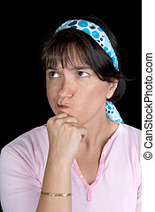 Woman pondering life. She is set off by a blue hair wrap...