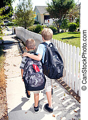 Walking home from school - Brothers walk home from their...