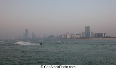 Abu Dhabi skyline - Jetski riders in front of the Abu Dhabi...