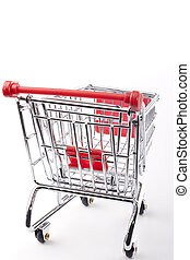 Empty shopping cart with the red handle on a white...