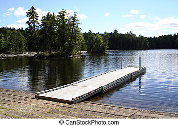 Travel Maine dock Greenville - Wooden dock on lake in...