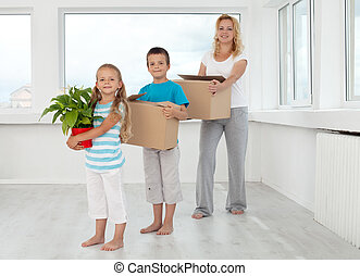 Family moving in a new home - Family moving into a new home...