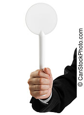 Auction paddle or voting card in hand - Human hand holding...
