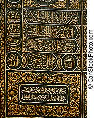 Arabic script on the black