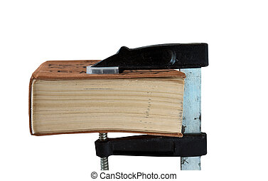 Compression - Thick book between the jaws of woodworking...