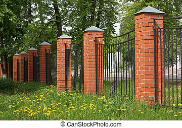 High fence with brick columns