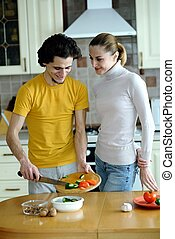Preparing vegetarian food - An image of couple in the kichen...