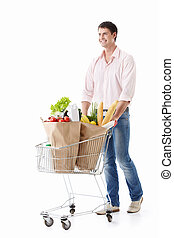 Buyer - A man with a cart with food on a white background