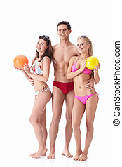 Attractive people - Young people in bathing suits with balls...