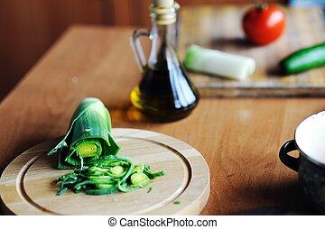Leek - An image of green leek on a wooden board
