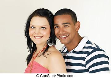 Smiling diverse couple - Portrait of a mixed race couple...