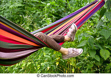 child lying in a hammock - small child lying in a hammock in...