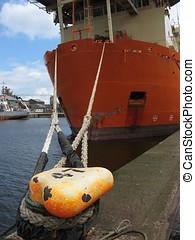 Ship\'s mooring ropes. - An orange ship tied up, close up of...