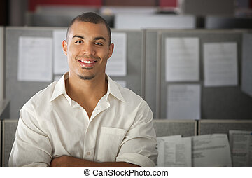 Confident Office Worker - Confident office worker smiles in...
