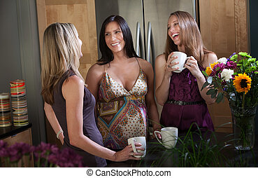 Smiling pregnant women with friends - Two pregnant women at...