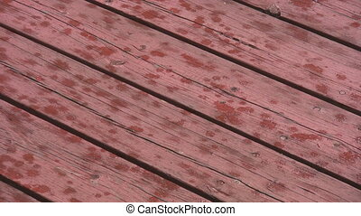 Rain on wood deck.