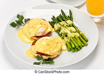 Eggs Benedict - Two poached eggs, and canadian bacon, on an...