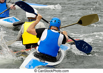 Kayak sport - Men are padling in kayaks