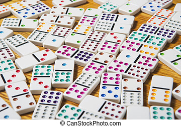 Domino pattern - A close-up shot of colorful dominoes.