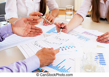financial and business documents on the table and human...