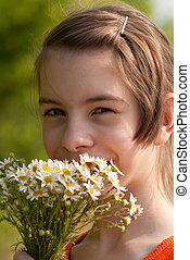 Teen girl with a bouquet of the wild flowers