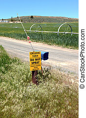 Organic agriculture sign. - A sign displaying a no spray of...