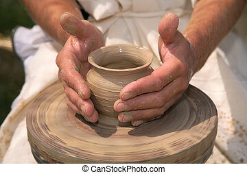 Hands of the potter - Magic transformation of a piece of...