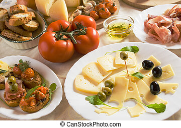 Italian appetizer food - Cold buffet with cheese, olives,...