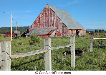 Old barn and fence, Oregon - Old barn fence and scattered...