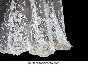White Lace - White lace up against a dark background.