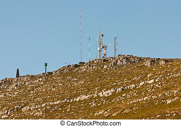Communication antennas on a rocky hill, Pombal - Portugal -...