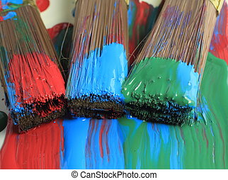 Paint Brushes 2 - Close up image of three very colorful,...