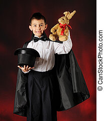 A Young Magician's Bunny - An elementary boy magician pulls...