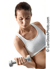 Pumping muscles - Image of fit woman doing exercise with...