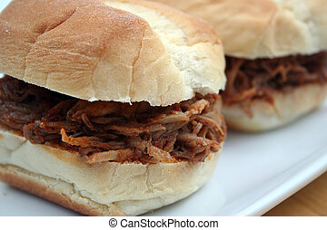 BBQ Pulled Pork Sandwiches - Close Up of Two Barbeque Pulled...