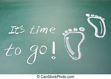 It is time to go! hand writing footprints and words on...