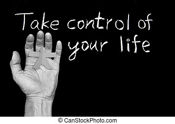 Take control of your life Words and human hand on blackboard...
