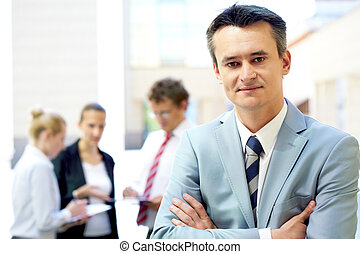Happy boss - Portrait of attractive male in suit looking at...