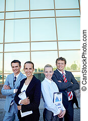 Managers - Group of confident employees with documents...
